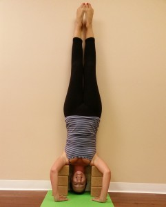 6 heather in supported headstand